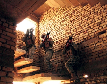 Soldiers entering building