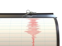 Seismograph instrument measuring ground movement during earthquake