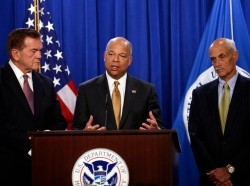 Dept. of Homeland Security Secretary Jeh Johnson and former DHS secretaries Michael Chertoff (R) and Tom Ridge (L) speak to reporters on the need for Congress to pass a full-year appropriations bill for the Homeland Security Department in February 2015
