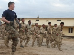 Iraqi soldiers perform physical training with 82nd Airborne