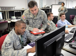 "Joint service and civilian personnel concentrate on exercise scenarios during ""Cyber Guard 2015."""