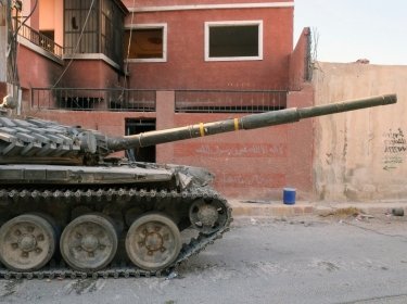 A tank of the Syrian National Army in the outskirts of Damascus on September 21, 2013