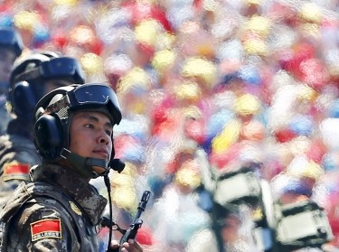 Soldiers of the People's Liberation Army of China arrive at Tiananmen Square during a military parade marking the 70th anniversary of the end of World War II, in Beijing, September 3, 2015