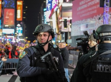 A member of the counterterrorism task force stands guard in Times Square, New York City, December 31, 2016