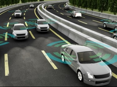 An illustration of autonomous cars on a road