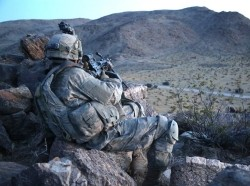 A U.S. Army Soldier assigned to 2nd Platoon, Alpha Company, 5th Battalion, 20th Infantry Regiment, 1st Brigade Combat Team, 2nd Infantry Division, provides security during Decisive Action Rotation 16-06 at the National Training Center in Fort Irwin, Calif