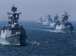 A fleet of ships sail out at sea as China and Russia's naval joint drill concludes in China