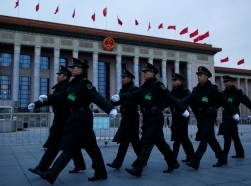 People's Liberation Army soldiers march outside the Great Hall of the People ahead of the opening session of the National People's Congress in Beijing, China, March 5, 2017