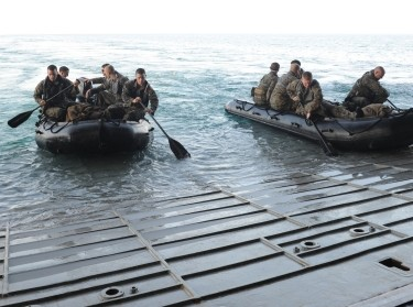 Expeditionary Unit (MEU) depart the well deck of the amphibious assault ship, USS Makin Island, in a combat rubber raiding craft during Tiger Strike 2016