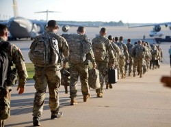 U.S. soldiers approach their transport plane on Pope Army Airfield at Fort Bragg, North Carolina, September 13, 2017