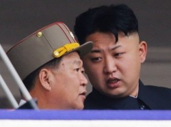 North Korean leader Kim Jong-un (right) speaks to Choe Ryong-hae, director of the General Political Bureau of the Korean People's Army, Pyongyang, July 27, 2013