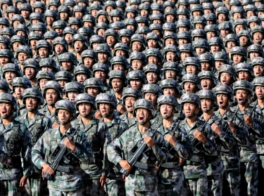 Soldiers of China's People's Liberation Army get ready for the military parade to commemorate the 90th anniversary of the foundation of the army at Zhurihe military training base in Inner Mongolia Autonomous Region, China, July 30, 2017