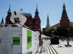 Vehicles of Russian state-controlled broadcaster Russia Today are seen near Red Square in Moscow, Russia, June 15, 2018
