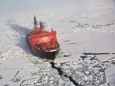 Russian nuclear ice breaker heading to the North pole through pack ice, aerial shot from helicopter