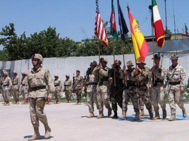 A U.S. soldier marches, followed by troops from various NATO countries, during a ceremony of the transfer of command in Herat, Afghanistan, May 31, 2005, photo by Ahmad Fahim/Reuters