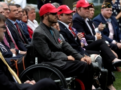 Veterans and other guests attend a signing ceremony for the VA Mission Act of 2018 in the Rose Garden of the White House, June 6, 2018, photo by Carlos Barria/Reuters