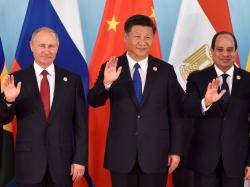Russian President Vladimir Putin, Chinese President Xi Jinping, and Egypt's President Abdel-Fattah el-Sisi at the 2017 BRICS Summit in Xiamen, China, September 5, 2017, photo by Kenzaburo Fukuhara/Reuters/Pool