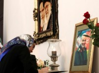 A woman signs a condolence book for Iranian Major-General Qassem Soleimani at the Iranian embassy in Minsk, Belarus, January 10, 2020