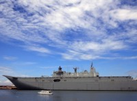 The Royal Australian Navy vessel Her Majesty's Australian Ship Adelaide (III) is escorted by a small boat upon arrival for a goodwill visit in Metro Manila, Philippines, October 10, 2017, photo by Romeo Ranoco/Reuters