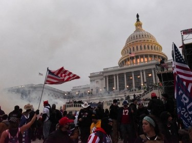 Police clear the U.S. Capitol Building with tear gas as supporters of then-President Donald Trump gather outside, in Washington, January 6, 2021, photo by Stephanie Keith/Reuters