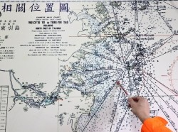 A Taiwanese coast guard points at a map showing the waters surrounding Matsu islands and mainland Chinese coast, at a coast guard office on Nangan island, the main island of the Taiwan-controlled Matsu islands, January 28, 2021, photo by Ann Wang/Reuters