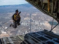 Army Sgt. 1st Class Cory Christiansen, a member of the Para-Commandos, U.S. Special Operations Command's parachute team, jumps out of an HC-130J Combat King II aircraft over Nellis Air Force Base, Nev., Nov. 15, 2019, photo by Air Force Airman 1st Class Dwane Young/U.S. Department of Defense