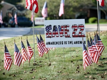 Veteran Jane DeGreef put up a display along Wilkshire Circle SW in North Canton, Ohio, to bring awareness to the issue of veteran suicide, September 17, 2021, photo by Julie Vennitti Botos/USA Today via Reuters