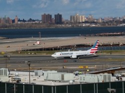 American Airlines flight 718, the first U.S. Boeing 737 MAX commercial flight since regulators lifted a 20-month grounding in November, lands at LaGuardia airport in New York, December 29, 2020, photo by Eduardo Munoz/Reuters