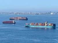 Container ships wait off the coast of the congested Ports of Los Angeles and Long Beach in Long Beach, California, October 1, 2021