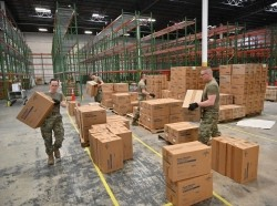 Members of the Maryland National Guard load medical supplies and equipment at the Maryland Strategic National Stockpile location on March 19, 2020, photo by MSgt. Christopher Schepers/U.S. Air National Guard