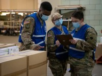 Oklahoma National Guardsmen conduct quality control on medical supply orders at the Strategic National Stockpile in Oklahoma City, April 20, 2020