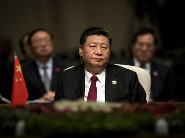 China's President Xi Jinping looks on during the BRICS Summit in Johannesburg, South Africa, July 26, 2018, photo by Gulshan Khan/Pool/Reuters