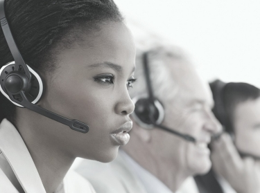 woman answering hotline