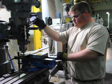 An Army depot machinist fabricates a piece of equipment