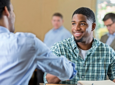 African American man shaking hands with potential employer at a job interview