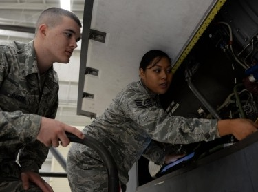 A maintenance instructor points out features of a remotely piloted aircraft