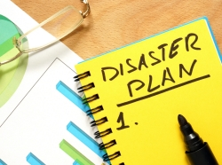 A notepad with a heading Disaster Plan