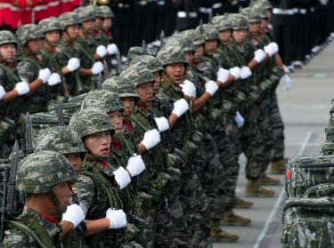 South Korean soldiers conduct a pass in review during a military parade to commemorate the 60th anniversary of the South Korean-U.S. alliance in Seoul, South Korea, October 1, 2013
