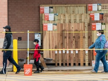 Shoppers line up to enter a Home Depot store as they practice social distancing to help slow the spread of COVID-19 in St. Louis, Missouri, April 4, 2020, photo by Lawrence Bryant/Reuters