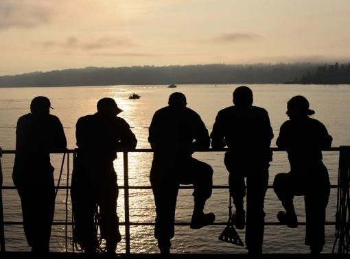 Sailors at the railing on the USS John C. Stennis