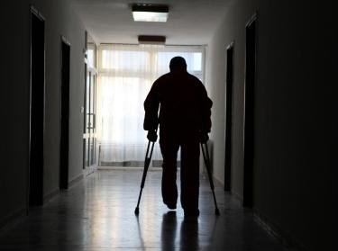 Disabled man in hospital corridor
