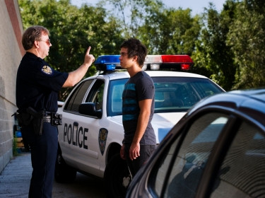 Police officer administering a sobriety check