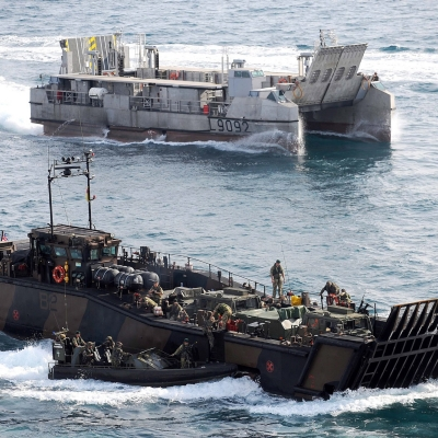 Royal Marine Landing Craft Utility (LCU) conducting cross decking drills with the French Marines with a French landing craft in the background