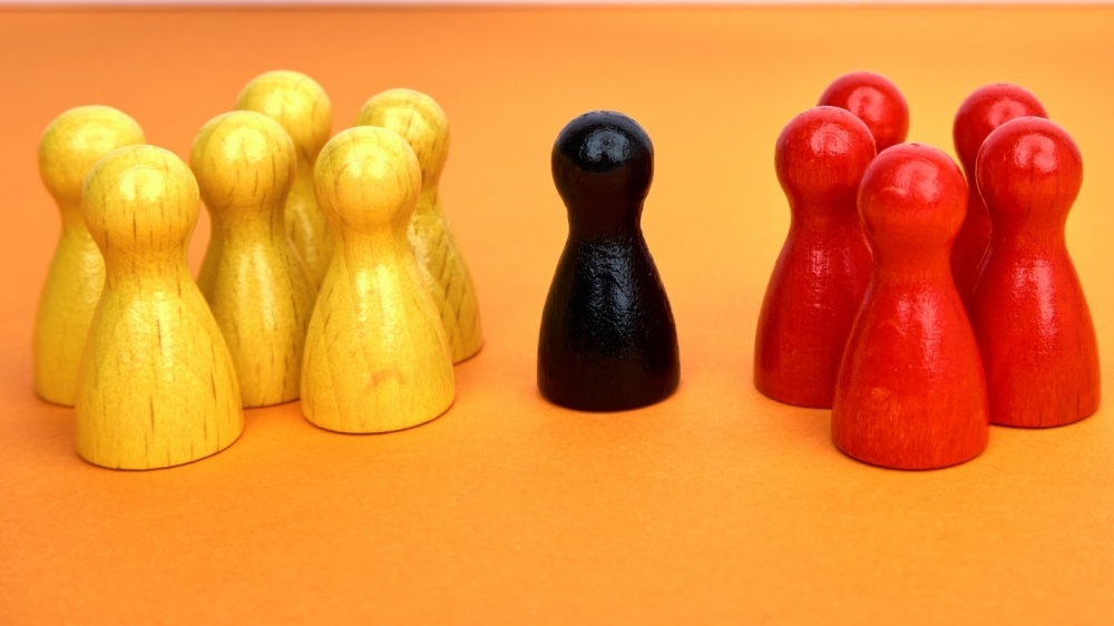Two groups of game pieces with one in the middle