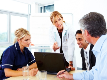 doctors in meeting with laptop
