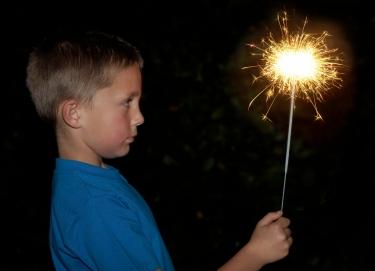 boy with sparkler firework