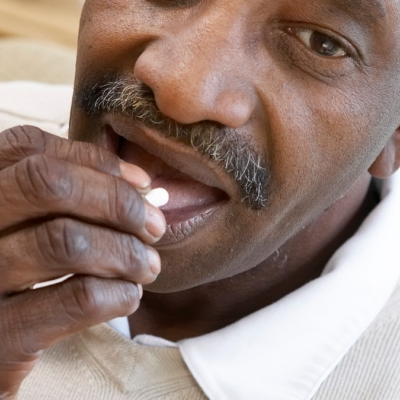 black man taking pill