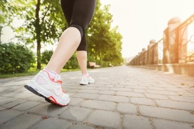 Woman jogging in a park, photo by Konstantin Postumitenko/Adobe Stock