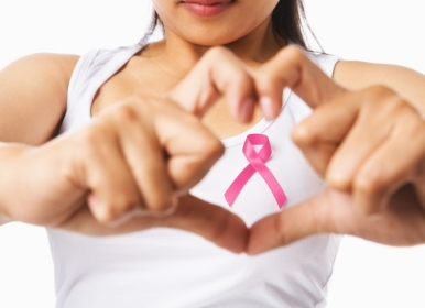 woman wearing breast cancer pink ribbon
