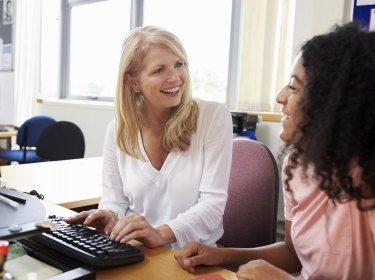 Careers advisor meeting female university student, photo by Monkey Business Images/Adobe Stock